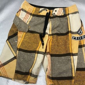 Volcom brown yellow board shorts size 30